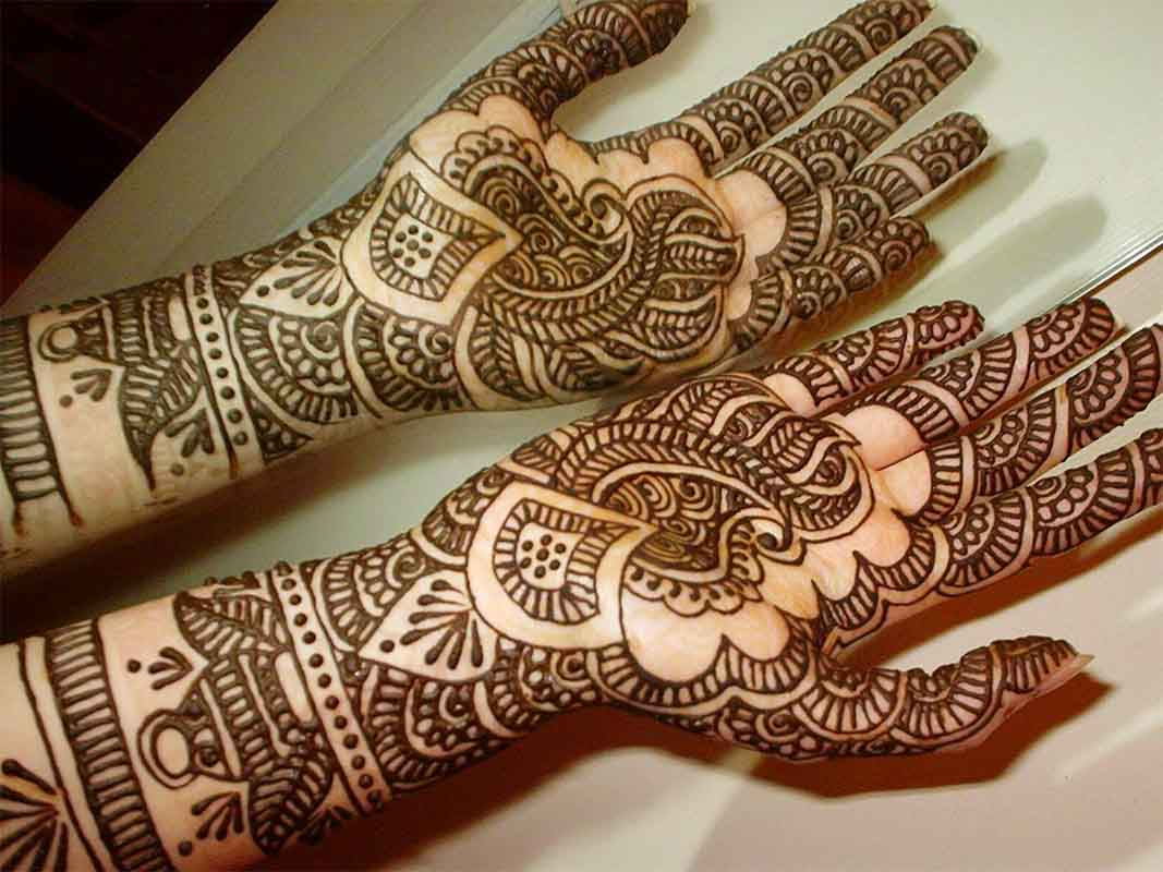 The best mehndi designs for hands livinghours - Mirrored Design