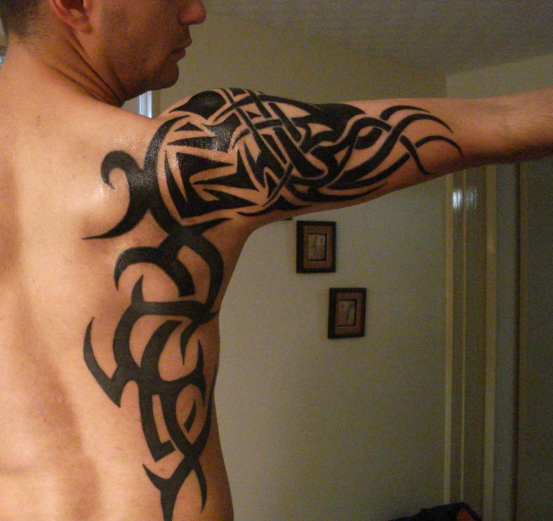 336c8db01 Erupting in flames is this tribal tattoo design that has a special tribal  tattoo meaning as well. The meaning behind this tattoo is that it reflects  ...