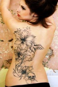 Tattoo with Bird, Skull & Flowers
