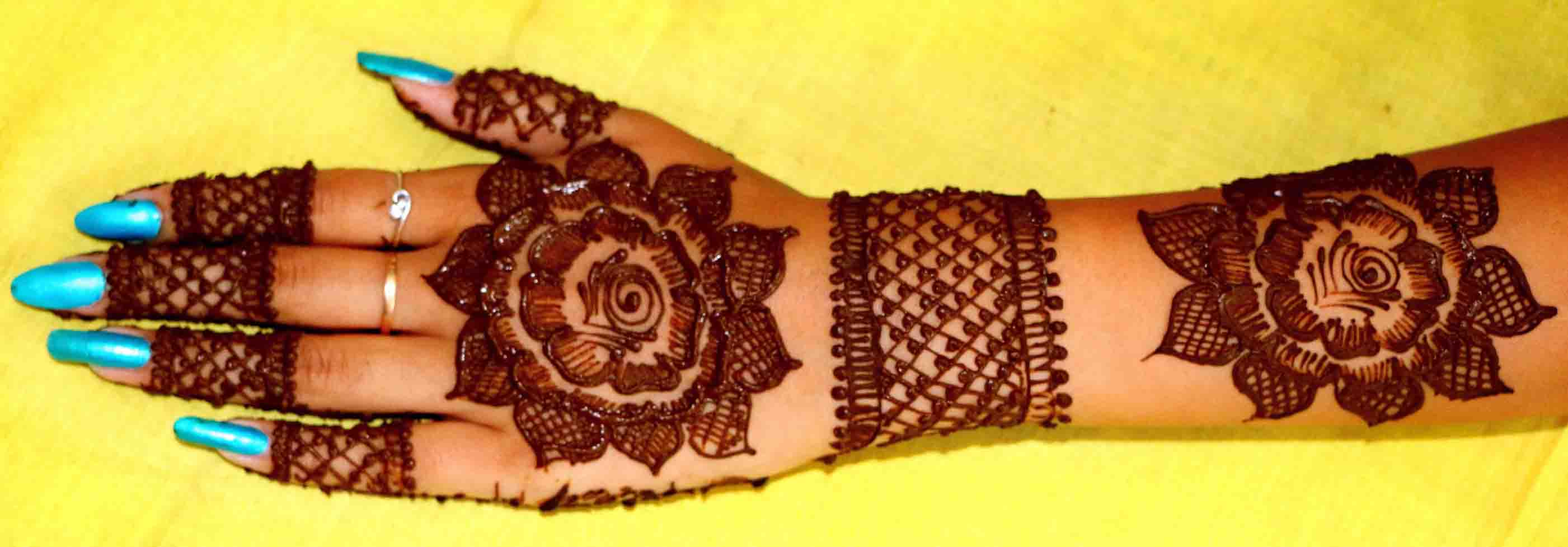 The best mehndi designs for hands livinghours - Wide Set Design
