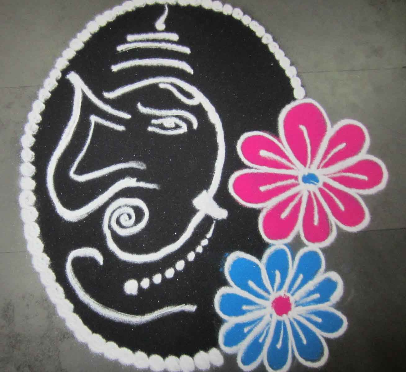 Black and white ganesh rangoli with flowers