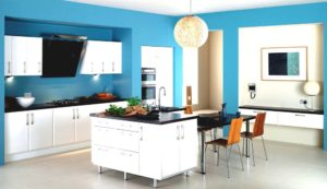 Blue kitchen with white cabinets