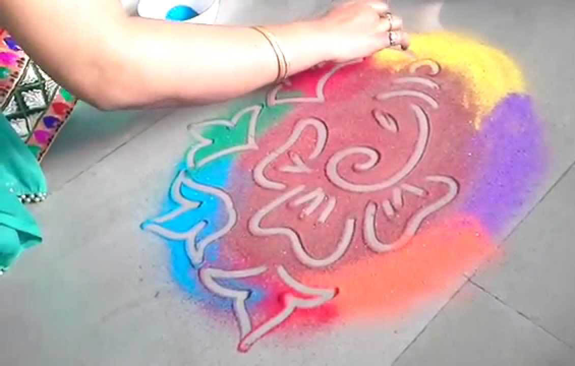 Color spray rangoli of Ganesh ji