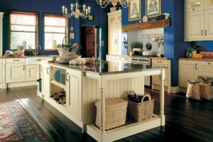 classic blue kitchen with cream cabinets and chandelier