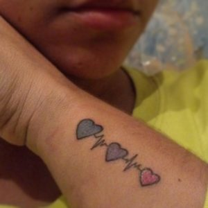 sister heartbeats tattoo