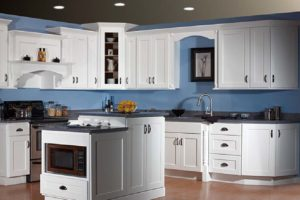 white kitchen cabinets with cool blue splash
