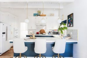 white theme kitchen with a touch of blue and brass