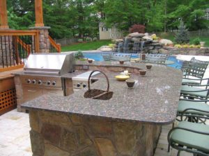 outdoor-kitchen-with-swimming-pool