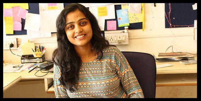 women entreprepreneur aditi gulta sitting on her desk