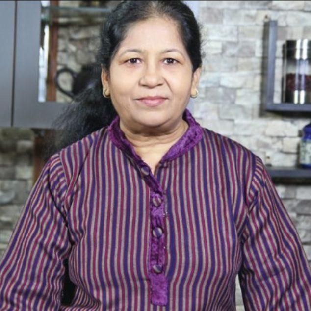 Youtuber Nisha Madhulika standing in her kitchen