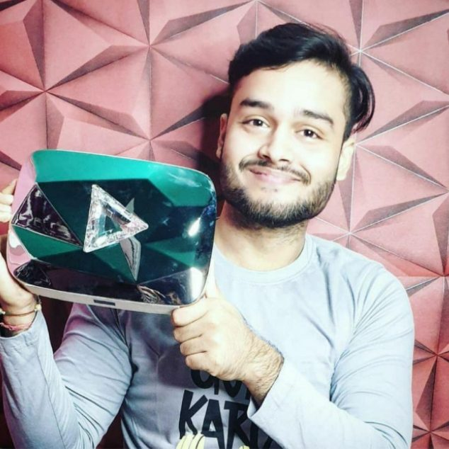 Youtuber Rajesh Kumar holding a diamond play button
