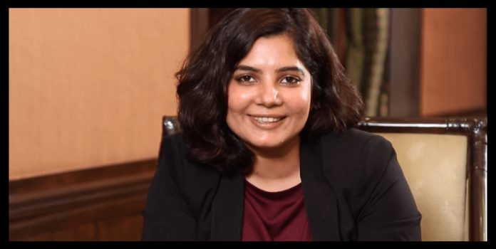 women entrepreneur Shradha Sharma sitting on chair