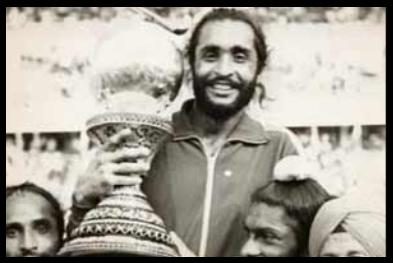 best hockey player udham singh holding a trophy